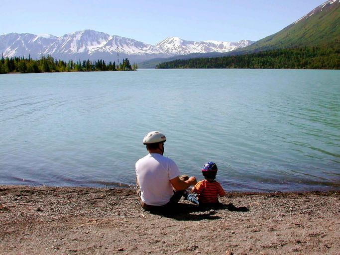 Father and child by a lake