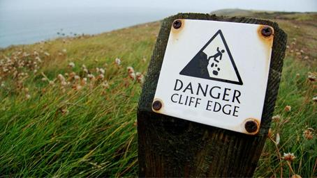 photo cliff edge with warning sign